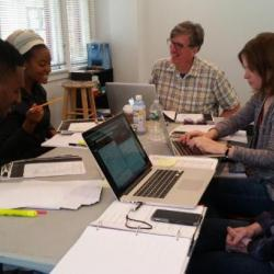 Cast members for <em>The Swallowing Dark</em> along with director Claire Moyer and dialect coach Len Kelly work on the show.